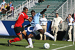14 November 2010: UNC's Jalil Anibaba (right) and Maryland's Ethan White (left). The University of Maryland Terrapins defeated the University of North Carolina Tar Heels 1-0 at WakeMed Soccer Park in Cary, North Carolina in the ACC Men's Soccer Tournament Championship game.