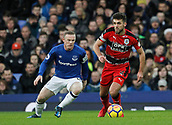2nd December 2017, Goodison Park, Liverpool, England; EPL Premier League football, Everton versus Huddersfield Town; Tommy Smith of Huddersfield Town goes past Wayne Rooney of Everton