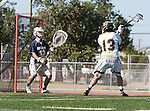 Tustin, CA 04/23/16 - Ryan Winn {La Costa Canyon #12) and Nathan Knight (Foothill #13) in action during the non-conference CIF varsity lacrosse game between La Costa Canyon and Foothill at Tustin Union High School.  Foothill defeated La Costa Canyon 10-9 in sudden death overtime.