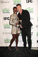 Lupita Nyong'o, Brad Pitt<br /> at the 2014 Film Independent Spirit Awards Press Room, Santa Monica Beach, Santa Monica, CA 03-01-14<br /> David Edwards/Dailyceleb.com 818-249-4998