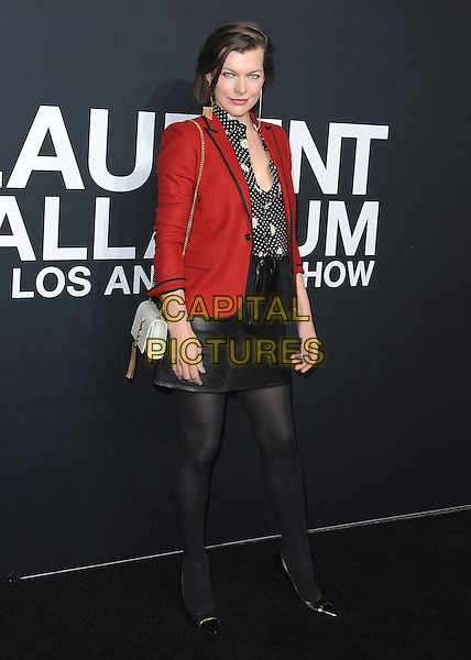 HOLLYWOOD, CA - FEBRUARY 10:  Milla Jovovich at Saint Laurent at The Palladium at the Hollywood Palladium on February 10, 2016 in Hollywood, California. <br /> CAP/MPI/PGSK<br /> &copy;PGSK/MPI/Capital Pictures