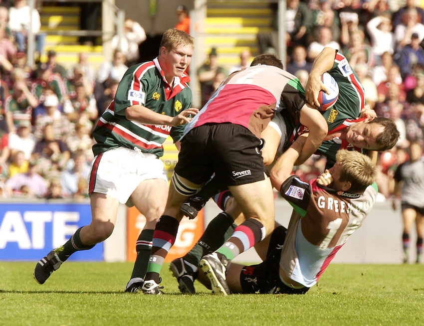 Photo. Jed Wee.Leicester Tigers v Harlequins, Zurich Premiership, Welford Road, Leicester. 7-9-2002..Leicester's Austin Healey (R) is tackled by Harlequins' Will Greenwood (ground) and Chris Bell.