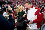 ESPN sideline report Erin Andrews interviews Wisconsin Badgers head coach Bret Bielema prior to the NCAA college football game against the Ohio State Buckeyes on October 16, 2010 at Camp Randall Stadium in Madison, Wisconsin. The Badgers beat the Buckeyes 31-18. (Photo by David Stluka)
