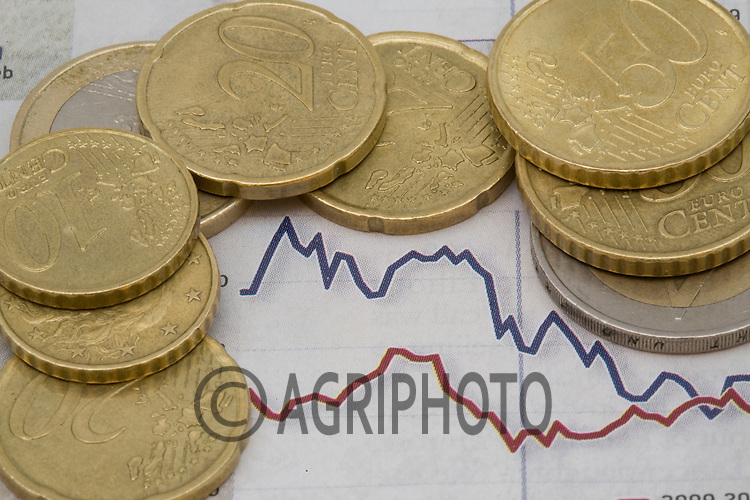 Euro Coins And Notes Against A Graph.
