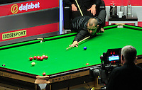 Barry Hawkins watches on as the red ball hits the jaw of the pocket before dropping in during the Dafabet Masters FINAL between Barry Hawkins and Ronnie O'Sullivan at Alexandra Palace, London, England on 17 January 2016. Photo by Liam Smith / PRiME Media Images