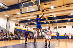 WATERBURY, CT. 09 December 2018-120918 - Crosby's Kerwin Prince #0 leaps up for an attempted tomahawk dunk with his teammate Justin Davis #1 and Chase Collegiate's Rafael Mahario #5, Jamal Clarke #21, and Robert Jones #3 all looking on during the annual Waterbury Boys Basketball Jamboree at Kennedy High School in Waterbury on Sunday. Bill Shettle Republican-American