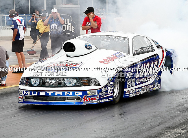 Larry Morgan #357, driver for Lucas Oil/Summit/Ford Racing's Pro Stock Car heating up his tires before making a run at the O'Reilly Fall Nationals held at the Texas Motorplex in  Ennis, Texas.