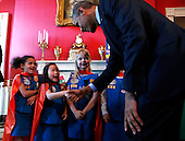 United States President Barack Obama shakes hands with a group of 6 year old Girls Scouts from Tulsa, Oklahoma who designed a battery powered page turner to help people who are paralyzed or have arthritis at the 2015 White House Science Fair, a celebration of students winners of STEM (Science, technology, engineering and math) competitions from across the country on March 23, 2015, in Washington, DC.<br /> Credit: Aude Guerrucci / Pool via CNP