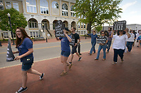 NWA Democrat-Gazette/BEN GOFF @NWABENGOFF<br /> Participants march around the Bentonville square Sunday, May 7, 2017, during a 'Die-In for ACA' hosted by Ozark Indivisible. The group marched around the square and lay down in a 'die-in,' with many holding tombstone-shaped signs carrying personal messages about how healthcare costs and losing coverage for pre-existing conditions could lead to their premature death. The event comes after the U.S. House of Representatives approved legislation Thursday to largely repeal and replace the Affordable Care Act.