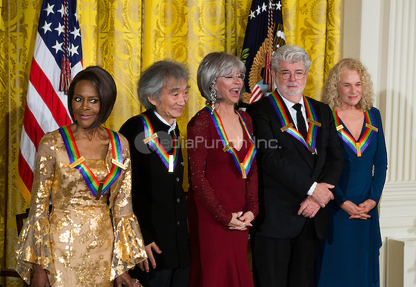 Actress and Broadway star Cicely Tyson (L), conductor Seiji Ozawa (C-L), actress and singer Rita Moreno (C), filmmaker George Lucas (C-R), singer-songwriter Carole King (R) attend the Kennedy Center Honorees Reception in the East Room of the White House in Washington, DC, USA, 06 December 2015. US President Barack Obama and First Lady Michelle Obama hosted the gathering. The 2015 Kennedy Center honorees are: singer-songwriter Carole King, filmmaker George Lucas, actress and singer Rita Moreno, conductor Seiji Ozawa, and actress and Broadway star Cicely Tyson.  <br /> Credit: Jim LoScalzo / Pool via CNP/MediaPunch