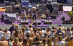 Third annual Mountain Aire Renaissance Fair and Musical festival produced by Rock'n Chair Productions.  On stage is the opening act Home Grown on June 13, 1976 at the Calaveras County Fairground near Angle Camp California.  Home Grown are from Modesto Michael Lingg, Bruce Johnson and Patrick Durr.  Photo by Al Golub
