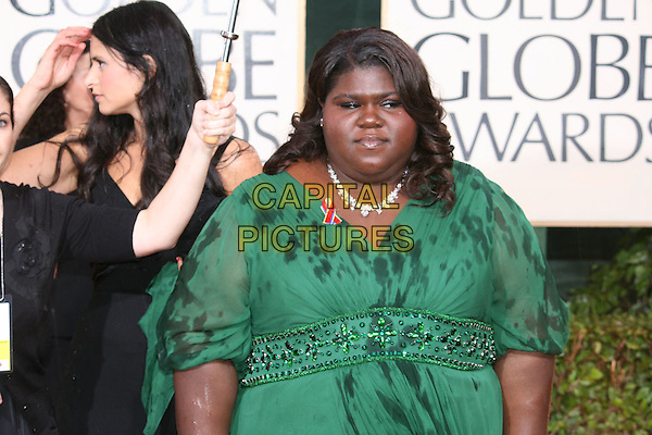"GABOUREY ""GABBY"" SIDIBE.Arrivals at the 67th Golden Globe Awards, he Beverly Hilton Hotel, Beverly Hills, California, USA, .January 17th, 2010..globes full length green dress raining wet necklace beaded  jewelled .CAP/AW/MAZ .©Maz/Weber/Capital Pictures."