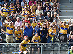 Clare fans celebrate a late point by John Conlon  in the closing stages of the All-Ireland quarter final at Pairc Ui Chaoimh. Photograph by John Kelly.