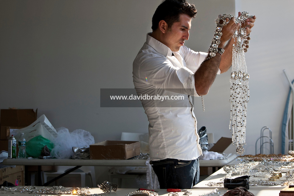 Jeweler to the stars Rodrigo Otazu examines a piece of his artwork during a photo shoot in New York, 8 November 2009.