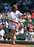 Chicago Cubs former first baseman Bill Buckner throws out the first pitch during a game against the New York Mets at Wrigley Field on July 15, 2006 in Chicago, Illinois.  (Mike Janes/Four Seam Images)