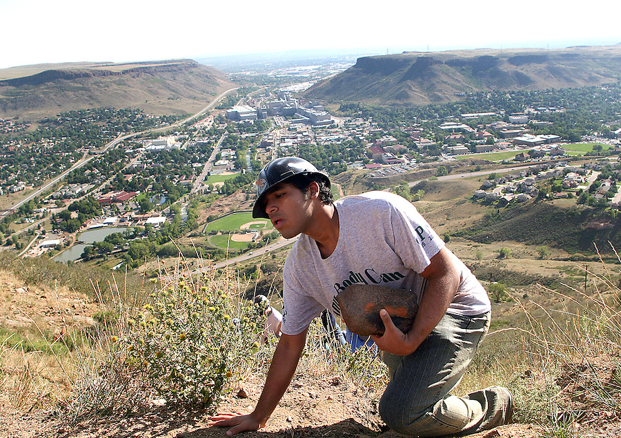 "Mohammed Al Aboalirat, 18, of Saudi Arabia falls to his knees while nearing the ""M"" on Mt. Zion during the traditional Colorado School of Mines event on Monday, August 21."