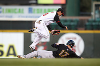 Rochester Red Wings shortstop Ray Chang #8 turns a double play as Danny Dorn #17 slides in during a game against the Louisville Bats at Frontier Field on May 9, 2011 in Rochester, New York.  Rochester defeated Louisville by the score of 7-6 in a marathon 18 inning game.  Photo By Mike Janes/Four Seam Images