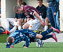 Stenny's Gregor Fotheringham and Forfar's Gavin Malin challenge for the ball.