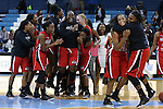 13 November 2015: Gardner-Webb players celebrate at the end of the game. The University of North Carolina Tar Heels hosted the Gardner-Webb University Runnin' Bulldogs at Carmichael Arena in Chapel Hill, North Carolina in a 2015-16 NCAA Division I Women's Basketball game. Gardner-Webb won the game 66-65.