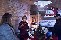 NWA Democrat-Gazette/CHARLIE KAIJO Charlotte Sorenson, volunteer tour guide, (second from left) shows tools inside the worker's cabin as Stephanie Smeja of Bentonville (left) and Phil Smeja (right) listen, Friday, November 29, 2019 at the Peel Mansion in Bentonville.<br /> <br /> Christmas decorations adorned the rooms of the Peel Mansion to welcome visitors. The Peel Compton Foundation will host their holiday fundraiser Christmas at the Mansion on December 6 from 6pm to 9pm. Proceeds from the event will help to keep the mansion running and keep admissions costs free. Visitors have enjoyed free admission to the mansion for over a year.