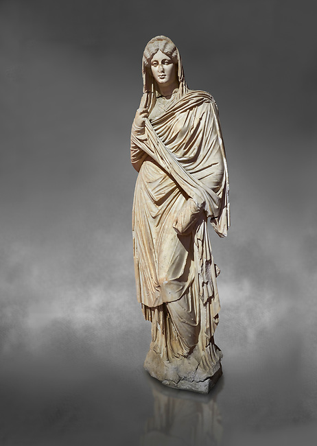 Roman statue of young Faustina. Marble. Perge. 2nd century AD. Inv no 3045 . Antalya Archaeology Museum; Turkey. Against a grey background