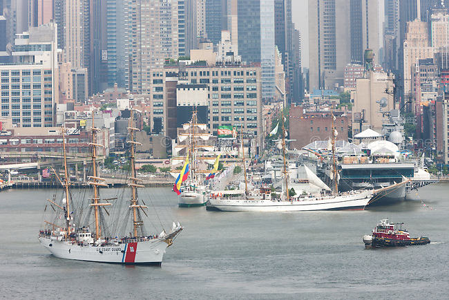 US Coast Guard Barque Eagle participates in the Parade of Sail on the Hudson River with other Tall Ships near the Intrepid Sea, Air, and Space Museum in New York City, USA on Wednesday, May 23, 2012.  The Parade of Sail kicked off Fleet Week New York City, an annual event celebrating sea services.
