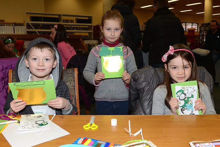 Matthew McEntee, Freya Ring and Dominyka Rudyte pictured at the St Patrick's day art and craft session in the library. Photo:Colin Bell/pressphotos.ie