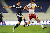 Marko Perovic (29) of the New England Revolution and Andrew Boyens (27) of the New York Red Bulls battle for tthe ball. The New York Red Bulls defeated the New England Revolution 3-0 during a U. S. Open Cup qualifier round match at Red Bull Arena in Harrison, NJ, on May 12, 2010.