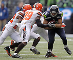 Seattle Seahawks wide receiver Jermaine Kearse (15) protects the football while being hit by Cleveland Browns defensive backs Tramon Williams (22) and  Tashaun Gipson (39 at CenturyLink Field in Seattle, Washington on December  ) 20, 2015. The Seahawks clinched their fourth straight playoff berth in four seasons by beating the Browns 30-13.  ©2015. Jim Bryant Photo. All Rights Reserved.
