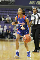 SEATTLE, WA - DECEMBER 18: Savannah State's #11 Rhianna Warren brings the ball down court against Washington.  Washington won 87-36 over Savannah State at Alaska Airlines Arena in Seattle, WA.