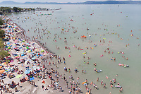 People take a summer bath in lake Balaton at Balatonlelle (about 140 km South-West of capital city Budapest), Hungary on July 14, 2018. ATTILA VOLGYI