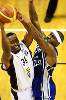 Saints import Damon Thornton pressures Heat import Mike Bell (left) during the National Basketball League match Wellington Saints and Harbour Heat at TSB Bank Arena, Wellington, New Zealand on Saturday 13 June 2009. Photo: Dave Lintott / lintottphoto.co.nz