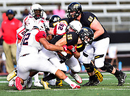 Baltimore, MD - OCT 14, 2017: Towson Tigers running back CJ Williams (25) carries a host of Richmond defenders defensive lineman Colby Ritten (92) and  defensive lineman Brandon Waller (32) on his way to a first during game between Towson and Richmond at Johnny Unitas Stadium in Baltimore, MD. The Spiders defeated the Tigers 23-3. (Photo by Phil Peters/Media Images International)