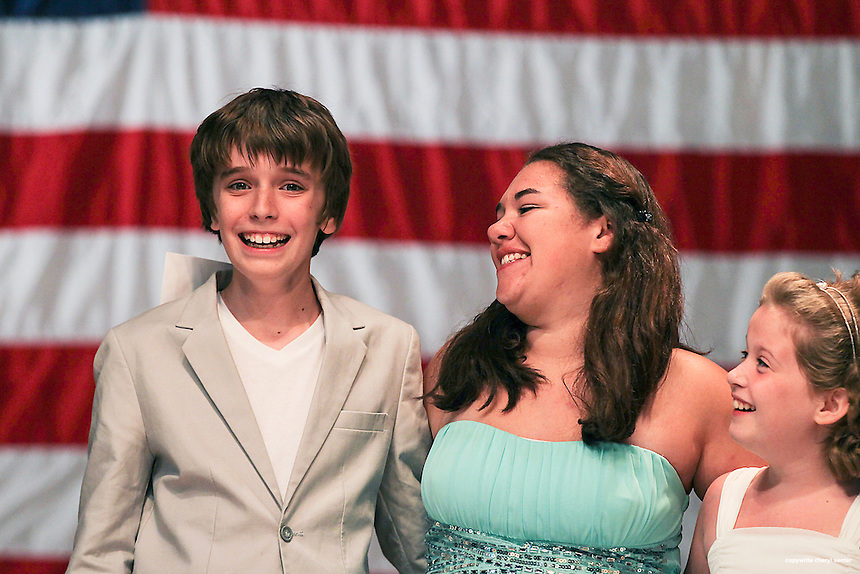 Winners, in the Junior category from left, first place Liam Swift of Portland, ME, Kaihla Laurent, 14, of Chicopee, MA, and Kayleigh MacFarland, 10, of Merrimack, NH in the ninth annual Hampton Beach Talent Competition at Hampton Beach in Hampton, N.H., Sunday, Aug. 25, 2013.  (Portsmouth Herald Photo Cheryl Senter)