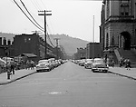 Pittsburgh PA:  Location photography of another Railway Express accident scene for attorney's Reed Smith, Shaw and McClay - 1953.  View of the Conroy Junior High School (on the right) at the corner of  Page and Fulton streets on the North Side of Pittsburgh.