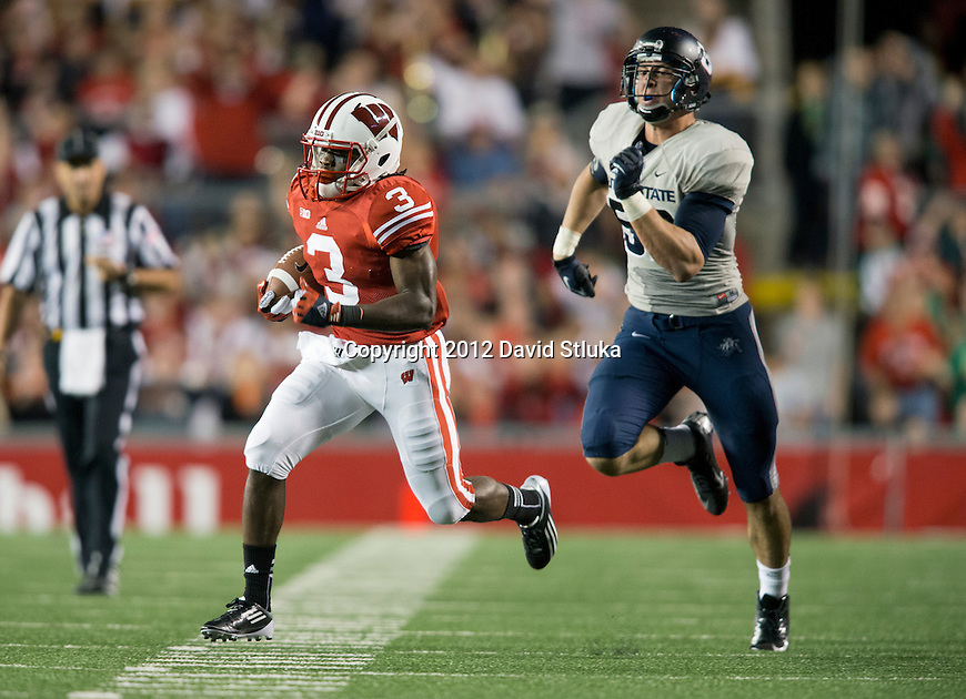 Wisconsin Badgers punt returner Kenzell Doe (3) returns a punt for a touchdown during an NCAA College Football game against the Utah State Aggies Saturday, September 15, 2012 in Madison, Wis. The Badgers won 16-14. (Photo by David Stluka)