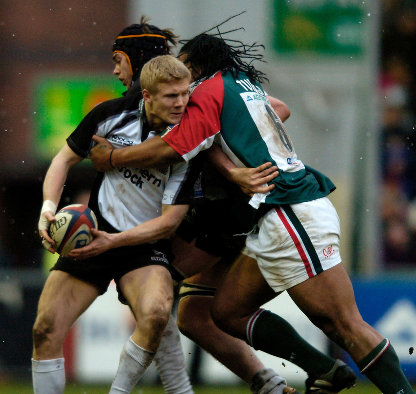 Photo: Richard Lane..Leicester Tiger v Newcastle Falcons. Zurich Premiership. 19/02/2005..Michael Stephenson is tackled by Henry Tuilagi.