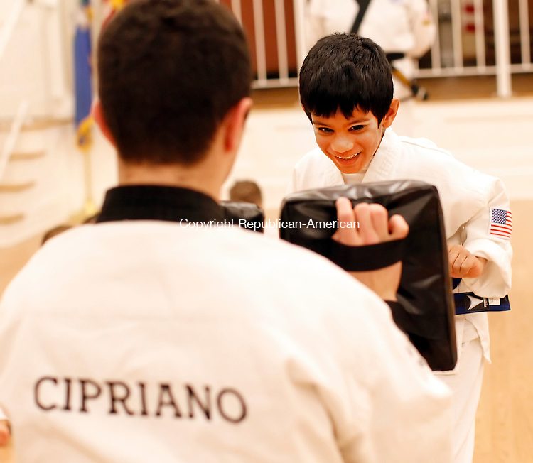 Middlebury, CT- 25 January 2013-012513CM04-  COUNTRY LIFE ONLY PLEASE--- Aarav Manjeshwar, 7,of Middlebury and an apprentice blue belt, practices self defense drills with Justin Cipriano, instructor with Middlebury Cheezic Tang Soo Do USA Martial Arts Friday afternoon in Middlebury.    Christopher Massa Republican-American