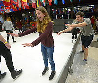 "NWA Democrat-Gazette/ANDY SHUPE<br /> Faith Schrader (left), a junior at the University of Arkansas from Fayetteville, laughs Thursday, Nov. 29, 2018, as she gets a push from Blake Miller, a junior from Dallas, as she skates on ""synthetic ice"" during the UARK Cardinal Nights Winter Wonderland inside the Arkansas Union on the University of Arkansas campus in Fayetteville. Attendees were also able to sing holiday karaoke, create a Christmas ornament, gingerbread house and snow globe in the days leading up to finals and the end of the fall semester. Donations of food and toys were accepted."