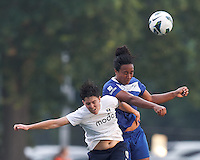Seattle Reign FC midfielder Keelin Winters (11) and Boston Breakers midfielder Mariah Noguiera (20) battle for head ball.  In a National Women's Soccer League (NWSL) match, Seattle Reign FC (white) defeated Boston Breakers (blue), 2-1, at Dilboy Stadium on June 26, 2013.