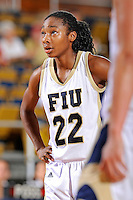 28 January 2012:  FIU guard Jerica Coley (22) prepares to shoot a free-throw in the second half as the FIU Golden Panthers defeated the Western Kentucky University Hilltoppers, 60-56, at the U.S. Century Bank Arena in Miami, Florida.  Coley, who has scored the second-most points of any women's player in the country, finished the game with 36 points and surpassed the 1,000 point mark.