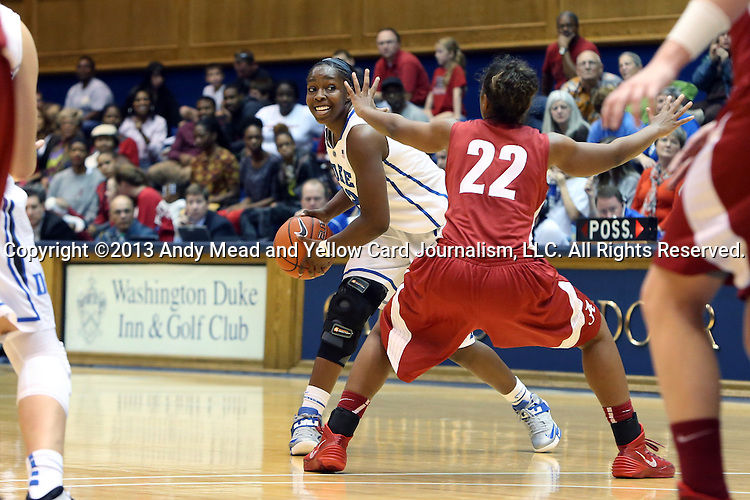 17 November 2013: Duke's Chelsea Gray (center) is defended by Alabama's Karyla Middlebrook (22). The Duke University Blue Devils played the University of Alabama Crimson Tide at Cameron Indoor Stadium in Durham, North Carolina in a 2013-14 NCAA Division I Women's Basketball game. Duke won the game 92-57.