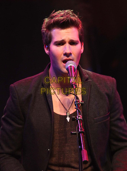 1 April 2013 - Los Angeles, California - James Maslow of Big Time Rush. BIG TIME RUSH Big tour Announcement and Performance Held At The House Of Blues.  .on stage in concert live gig performance performing music headshot portrait half length black suit jacket singing .CAP/ADM/KB.©Kevan Brooks/AdMedia/Capital Pictures.