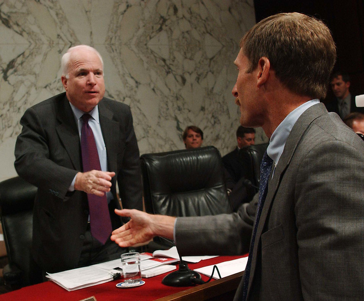 10/06/04.IRAQ AND WEAPONS OF MASS DESTRUCTION--Sen. John McCain, R-Ariz., greets witness Charles A. Duelfer, right, Special Advisor to the Director of Central Intelligence for Strategy Regarding Iraqi Weapons of Mass Destruction Programs, before a Senate Armed Service hearing to receive a report on Iraqi weapons of mass destruction programs. Brigadier General Joseph J. McMenamin, USMC, commander of the Iraq Survey Group, also testified..CONGRESSIONAL QUARTERLY PHOTO BY SCOTT J. FERRELL