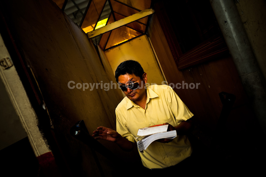 A blind man, holding books, walks up the stairs in the corridor of Unión Nacional de Ciegos del Perú, a social club for the visually impaired in Lima, Peru, 3 April 2013. Unión Nacional de Ciegos del Perú, one of the first societies for disabled in Latin America, was established in 1931 to provide a daily service for blind and partially sighted people from the capital city. The range of activities includes reading books in a large Braille library, playing chess or using a computer adapted for visually impaired individuals. As the majority of the blind does not have a regular job, the UNCP club offers them an opportunity to learn and lately, to provide massages to the club visitors and thus generate some income.