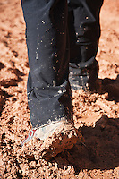 Muddy hiking boots of hiker on Queens Garden trail, Bryce Canyon national park, Utah, USA