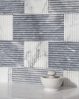 Kiawah Kente Grand, a hand-cut stone mosaic, shown in honed Allure, honed Calacatta, and zinc. Designed by Joni Vanderslice as part of the J. Banks Collection for New Ravenna.