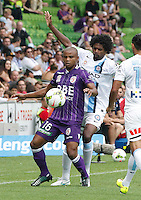 Sidney controls the ball past  Kew Jaliens  during the  A-League soccer match between Melbourne City FC and Perth Glory at AAMI Park on February 22, 2015 in Melbourne, Australia.