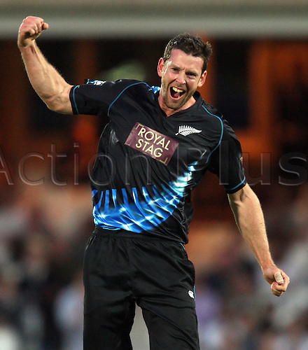 25.06.2013 London, England. Ian Butler of New Zealand celebrates after taking the wicket of Eoin Morgan during the International T20 series game between England and New Zealand from the Kia Oval.