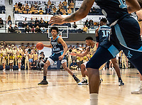 WASHINGTON, DC - FEBRUARY 8: Jeff Dowtin #11 of Rhode Island starts an attack during a game between Rhode Island and George Washington at Charles E Smith Center on February 8, 2020 in Washington, DC.